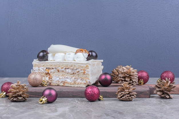 A slice of coconut cake with christmas decoration
