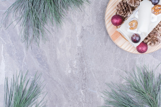 A slice of coconut cake on a wooden board in christmas concept