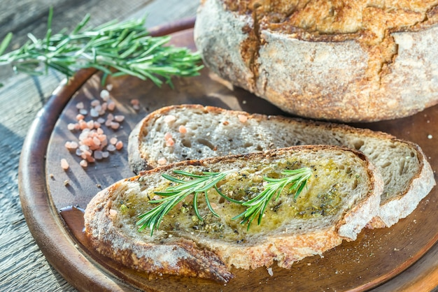 Slice of fresh bread with olive oil and herbs