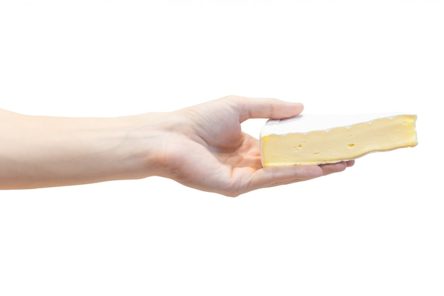 A slice of fresh brie cheese in men's hand isolated on white