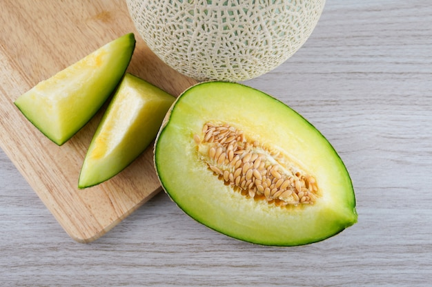 Slice of japanese melons,honey melon or cantaloupe  isolated on wooden . fruit and supplements for good health