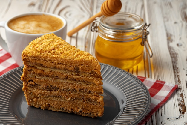 Slice of layered honey cake on plate