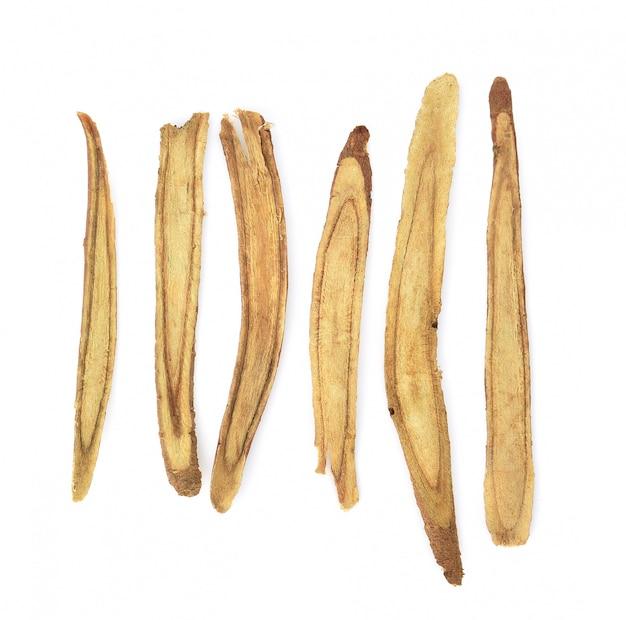Slice licorice roots on white background