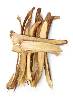 Slice licorice roots on white