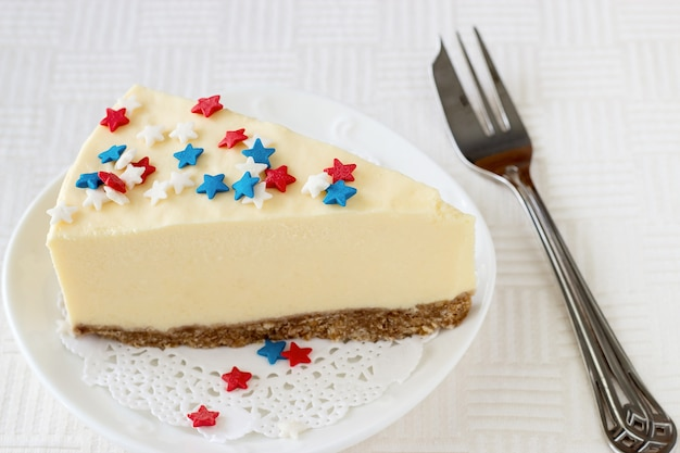 Slice new york cheesecake white plate served for celebration july 4th in usa.