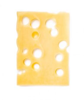 白で隔離されるチーズのスライス