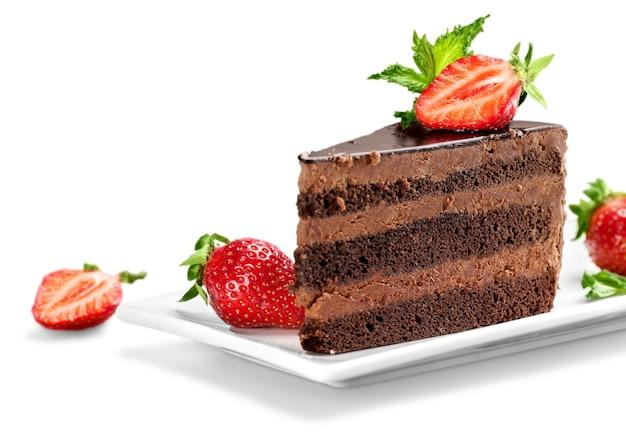 白の上のおいしいチョコレートケーキのスライス(サンプルテキスト付き)