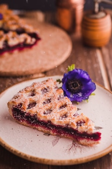 Slice of delicious tart with flower