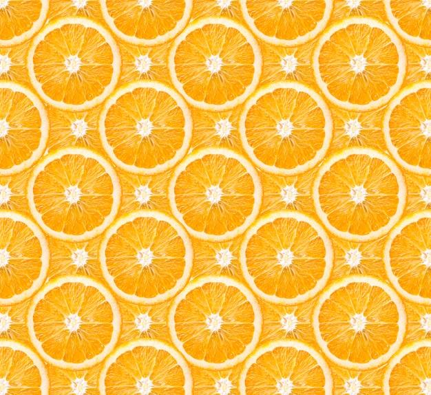 オレンジ色の果物の背景パターンのスライス