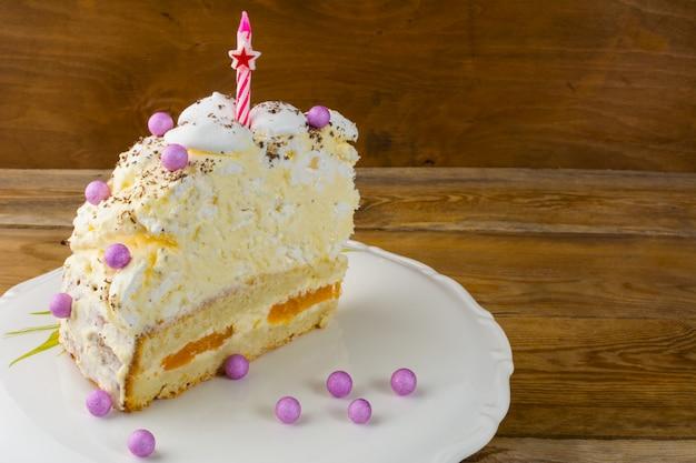 Slice of peach and meringue birthday cake