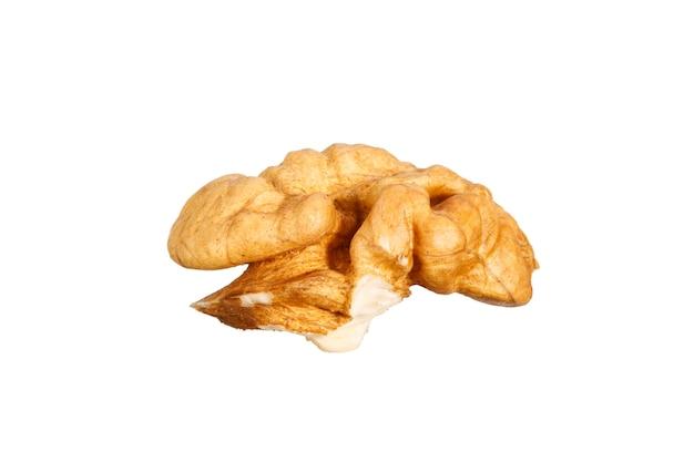 Slice of peeled walnut isolated on white background. high quality photo