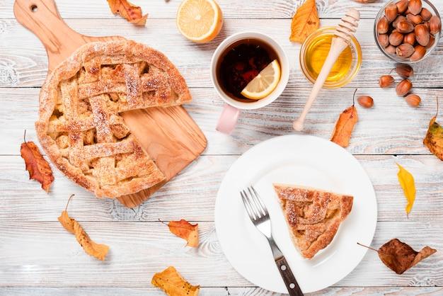 Slice of pie with tea and honey