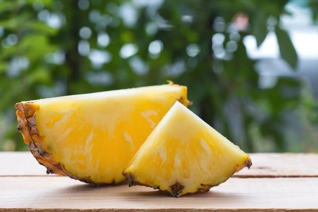 Slice of pineapple on table.