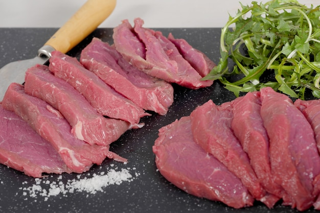 Slice of raw beef with salad