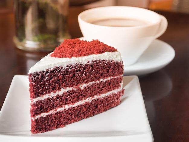 Slice of red velvet cake on a white plate.