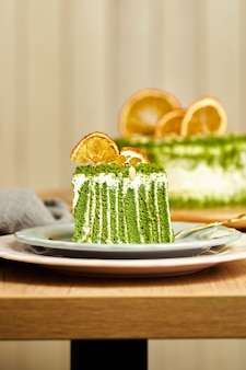 Slice of spinach cake on plate