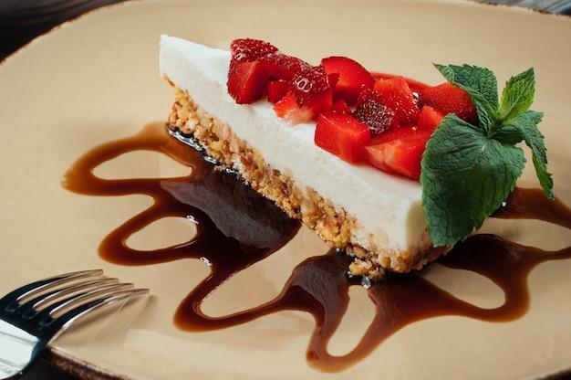 Slice of strawberry cake, selective focus