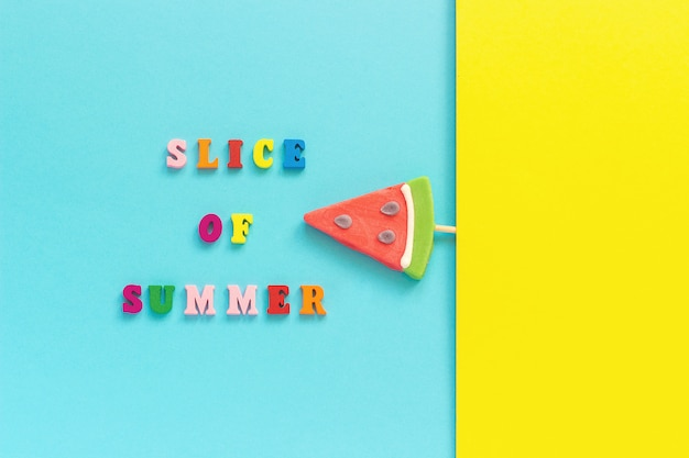 Slice of summer, pineapple and watermelon lollipopson blue yellow background.