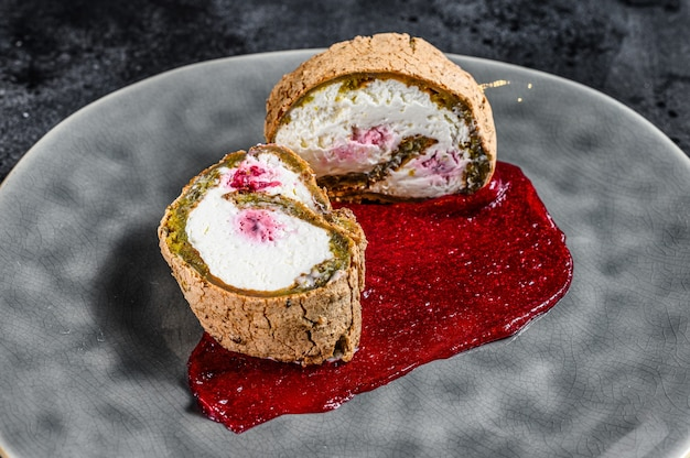 Slice of swiss roll with strawberry jam and cream