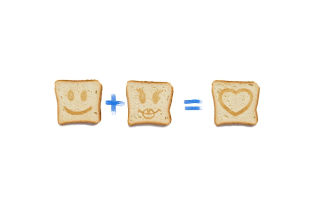 Slice of a toast with boy face plus slice of a toast with girl face is equal to love. on a white background.
