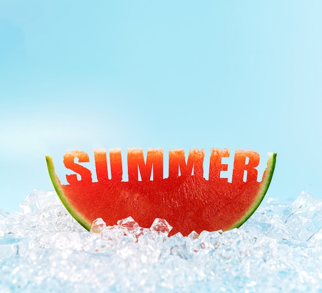 A slice of watermelon on the ice, in which the word summer is carved.
