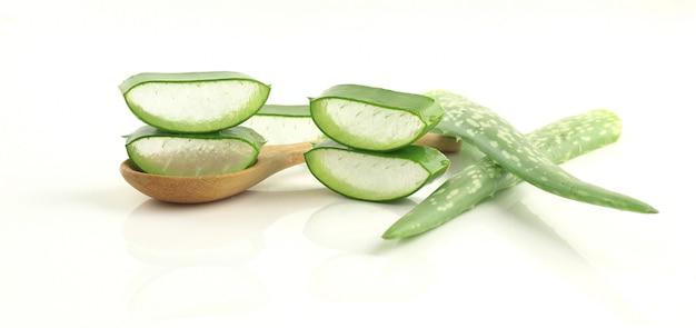 Sliced aloe vera on spoon herbal medicine for skin and hair on white