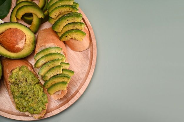 Sliced avocado on toasted bread for healthy breakfast.