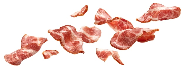 Sliced bacon isolated on white background falling ham strips