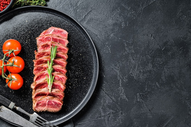 Нарезанный стейк из говядины top blade, черный ангус