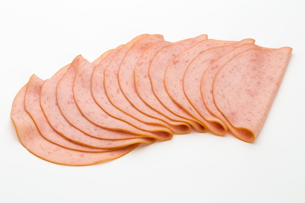 Sliced boiled ham sausage isolated on white background.