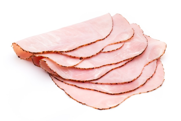 Sliced boiled ham sausage isolated on white, top view.