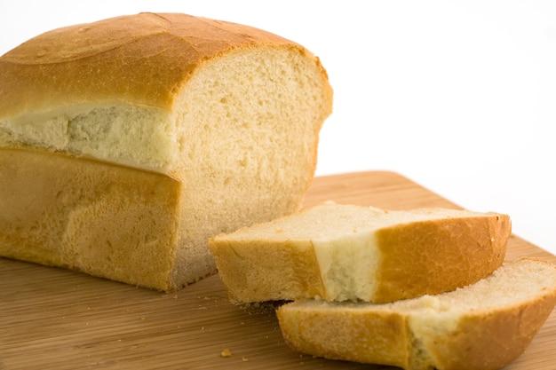 Sliced bread on chopping board