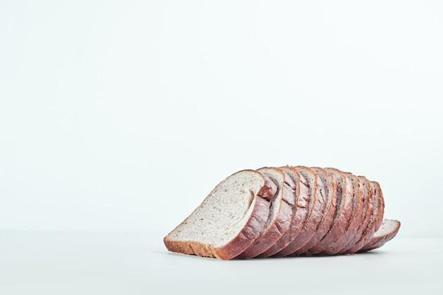 Sliced bread on grey table.