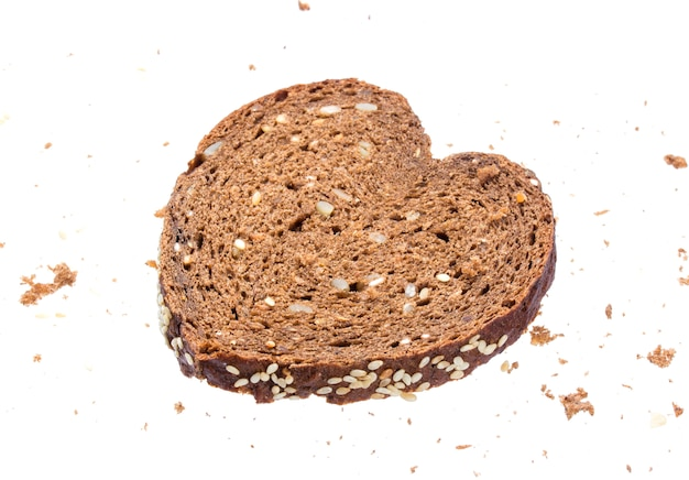 Sliced bread in the shape of heart on white background