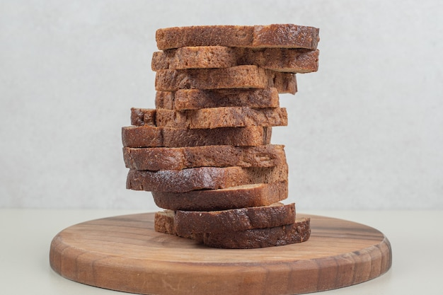 Sliced brown bread on white background. high quality photo