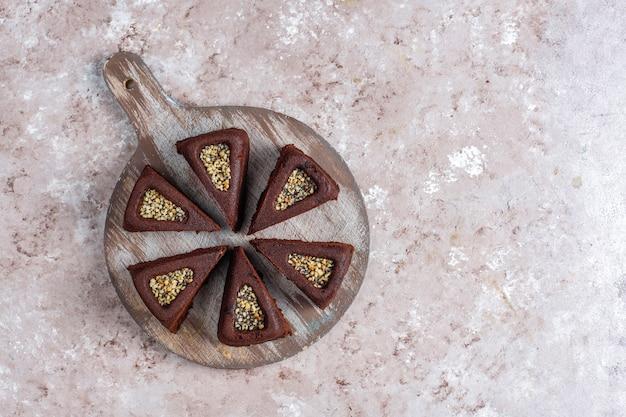 Sliced brownie cake with hazelnuts.