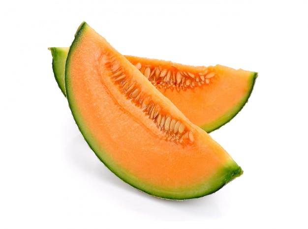 Sliced cantaloupe melon isolated on white wall
