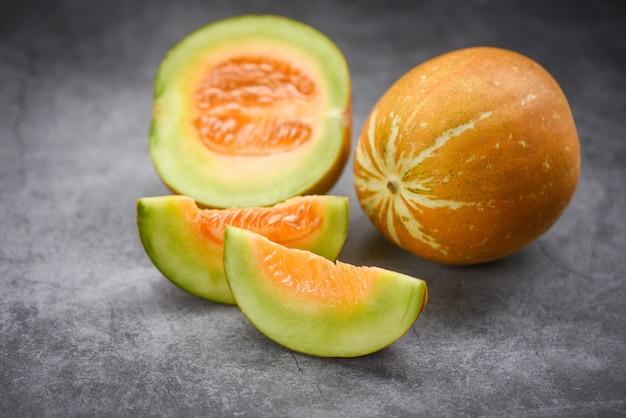 Sliced cantaloupe thai tropical fruit asian on dark , cantaloupe melon muskmelon cucurbitaceae