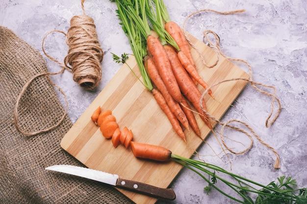 Sliced carrots for salad on a wooden platform