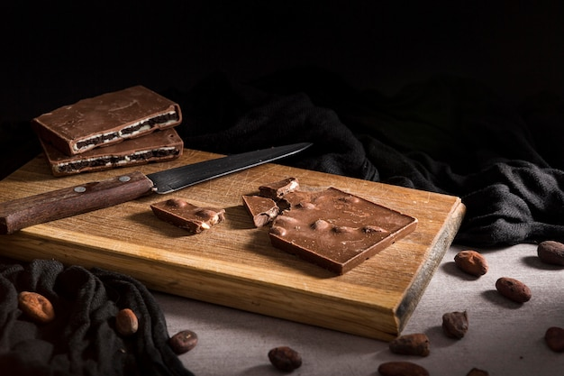 Sliced chocolate bar on cutting board