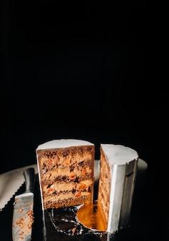 Sliced chocolate wedding cake cake with amazing filling on black