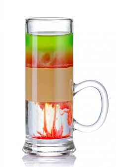 Sliced colorful shot drink cocktail isolated on white