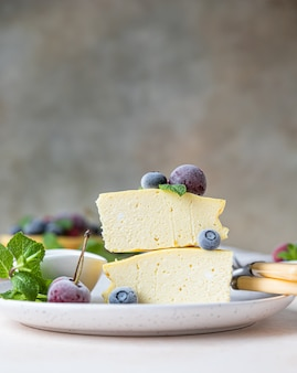 Sliced cottage cheese casserole or no crust cheesecake decorated with berries and mint