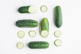 Sliced cucumbers on white background