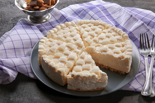 Sliced delicious cheesecake on plate