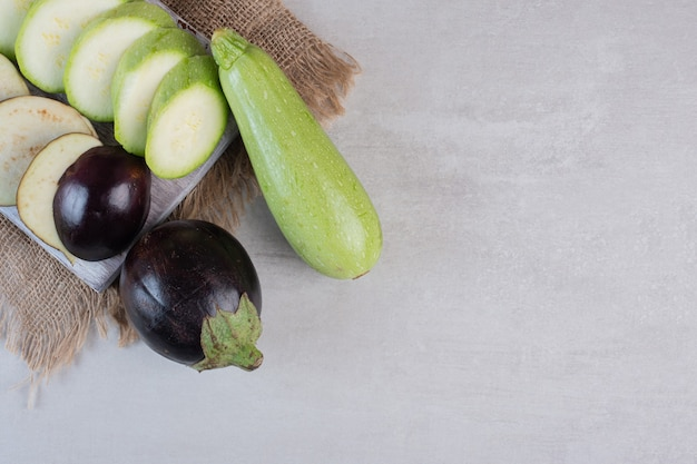 Sliced eggplants and zucchini on wooden board. high quality photo