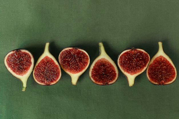 Sliced figs on the background of a green napkin top view.