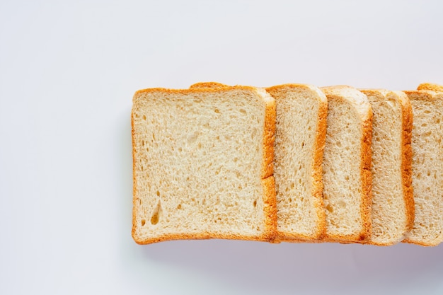 Sliced fine whole wheat bread on white background