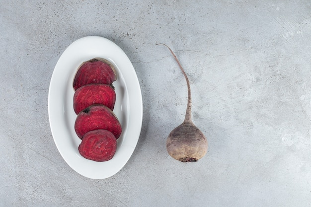 Sliced fresh beetroot vegetable on a dark board. high quality photo