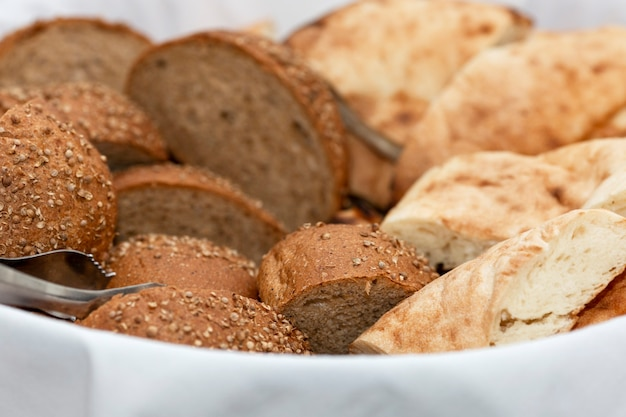 Sliced fresh bread in a basket. catering for business meetings, events and celebrations.
